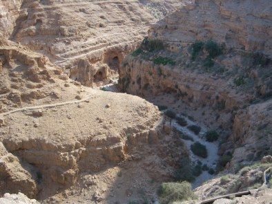 Wadi Qelt (Arabic) or Nahal Prat (Hebrew) is a river bed running west to east through the Judean Desert. The Jericho Road winds along it and over it, sometimes very narrowly.