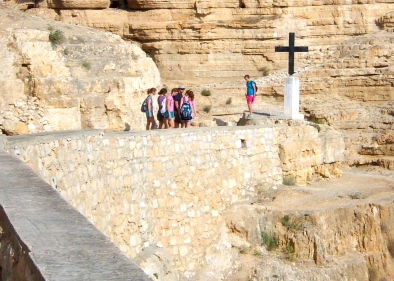 The pilgrim's path is marked by the cross.