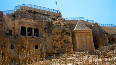 """Two of the more historic tombs are carved into the eastern valley wall. The first, on the left, is the tomb for the """"Sons of Hezim,"""" a family of priests. The second, more distinct, is """"Hezekiah's Tomb."""""""
