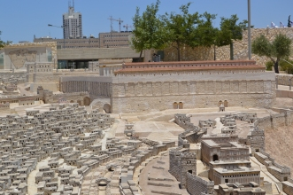 The Temple Mount is shown here, an impressive construction in comparison to the city around it.