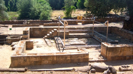 """In 1 Kings 12:26-33, Jeroboam, the new king of the Northern Kingdom (called """"Israel""""), builds a worship center here in Dan in order to assert the Northern Kingdom's religious independence from Judah, the Southern Kingdom, where Jerusalem and the temple where found. You can see here the foundations for storerooms and priests' chambers in the background, and a reconstruction of what the altar would have looked like."""