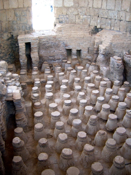 Pictured here is one of the bath rooms. A great furnace would be lit adjacent to these rooms, so that the heat would flow under a raised floor to warm the tiles and water above.