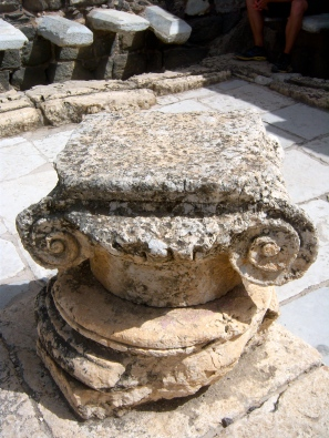 "The scroll-style capital is called ""Ionic,"" for their Greek origins. These are rarer to find, because they are older than the more ornate ""Corinthian"" capitals favored in Roman architecture."